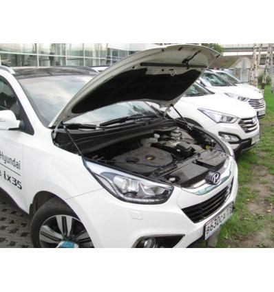 Амортизатор (упор) капота на Hyundai ix 35 UP 2744